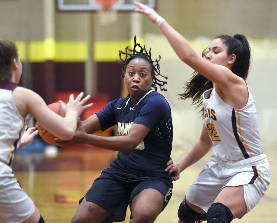 Ashanti Frazier (center) of Newington drives past Molly Smolenski (left) and Caitlyn Velez of Sheehan during the second half in Wallingford on January 20, 2020. Photo: Arnold Gold / Hearst Connecticut Media / New Haven Register