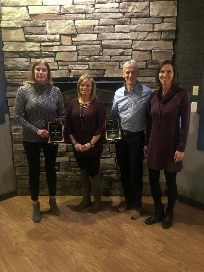 Each year, the Manistee Recreation Association presents the Charles E. Schoedel outstanding award to an individual and an organization. Pictured (from left to right) are Wendy Adamski (individual award winner), MRA executive director Stephanie Carpenter, and Geoff and Mary Paine of Water's Edge Dentistry (organization award winner). (Courtesy photo)