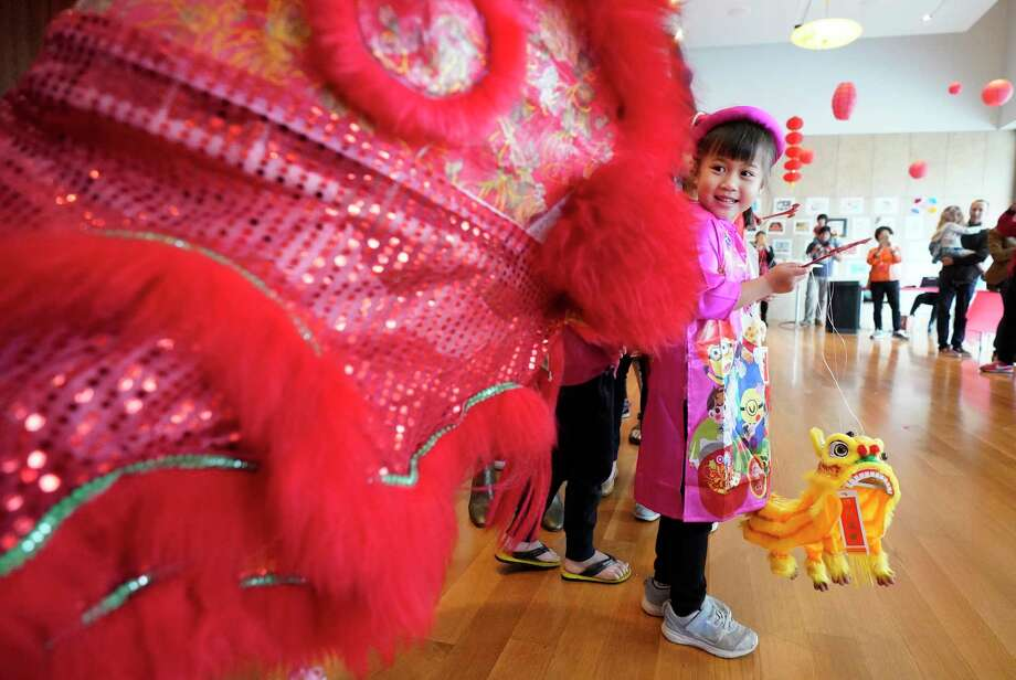 Jayden Cao, 5, watches a lion dance during the Lunar New Year Family Day event Saturday, Jan. 25, 2020, at the Asia Society Texas Center, 1370 Southmore Blvd., in Houston. As part of the Year of the Rat celebration, activities included performances, food, shopping and art and crafts. Photo: Melissa Phillip, Staff Photographer / © 2020 Houston Chronicle