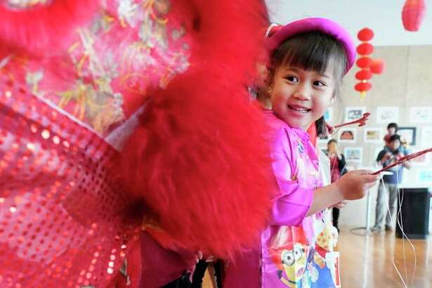 Jayden Cao, 5, watches a lion dance during the Lunar New Year Family Day event Saturday, Jan. 25, 2020, at the Asia Society Texas Center, 1370 Southmore Blvd., in Houston. As part of the Year of the Rat celebration, activities included performances, food, shopping and art and crafts.