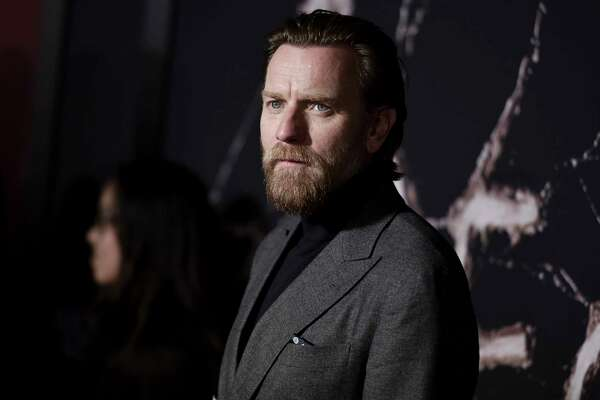 "FILE - In this Oct. 29, 2019 file photo, Ewan McGregor attends the LA premiere of ""Doctor Sleep"" at the Regency Theatre Westwood in Los Angeles. McGregor says any delay in completing work on in his new Obi-Wan Kenobi a€œStar Warsa€ series will be brief and is aimed at making the show better. McGregor addressed trade reports that the Disney Plus series had been placed on hold at an event Thursday, Jan. 23, 2020, promoting his latest film a€œBirds of Prey.a€ (Photo by Richard Shotwell/Invision/AP, File)"