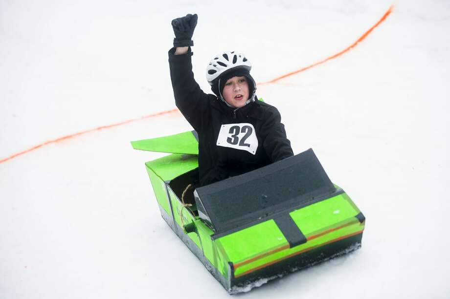 Sledders race one another in one-of-a-kind sleds, constructed from cardboard, during the second annual cardboard sled races hosted by the City of Midland Parks and Recreation Saturday, Jan. 25, 2020 at City Forest. (Katy Kildee/kkildee@mdn.net) Photo: (Katy Kildee/kkildee@mdn.net)