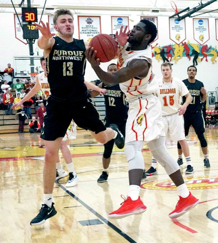 Ferris State's Dorian Aluyi fights for a rebound with Anthony Barnard of Purdue Northwest during the Bulldogs' 82-77 victory on Saturday afternoon at Wink Arena. (Pioneer photo/Joe Judd)