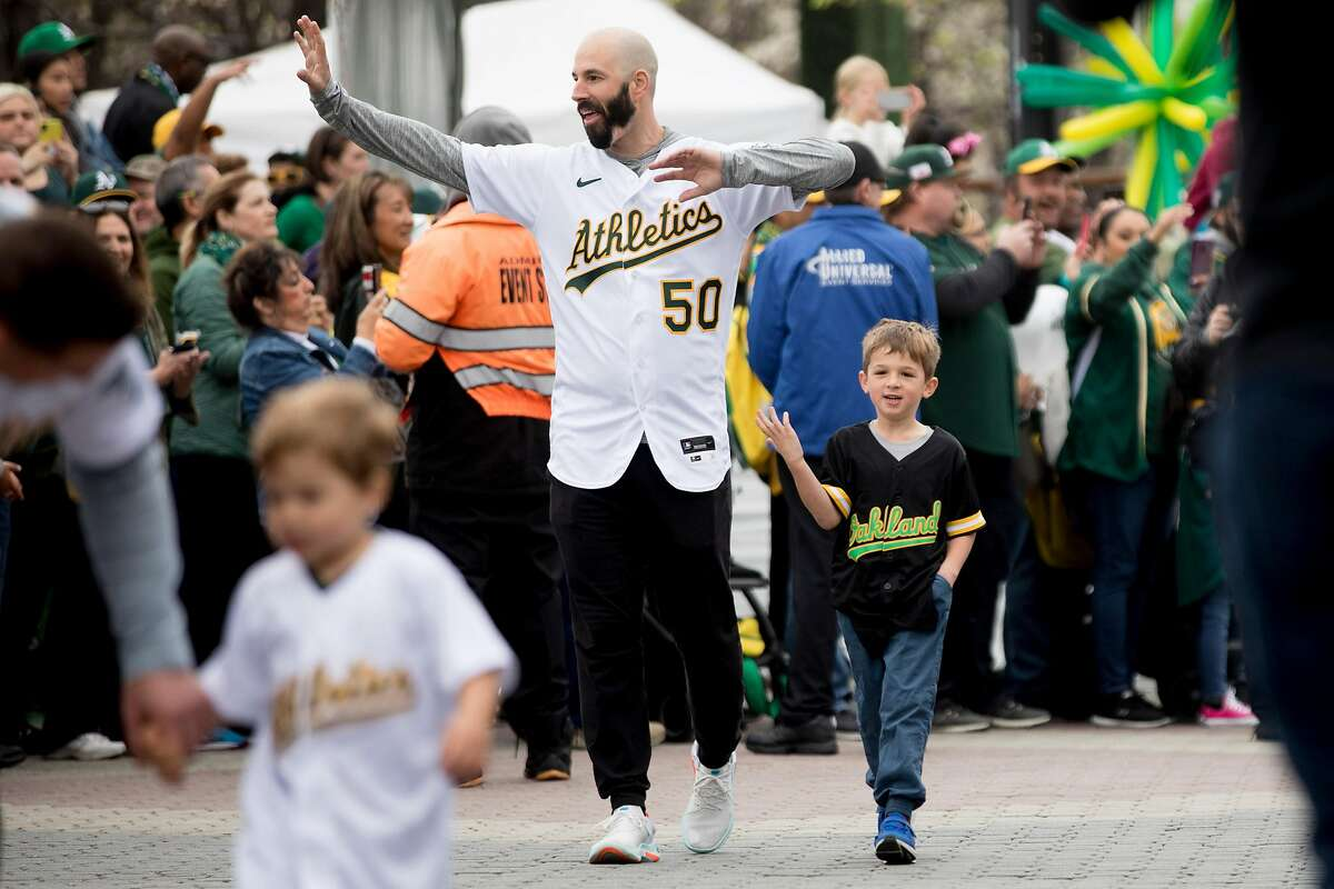 Oakland A's pitcher Mike Fiers walks along the parade route during the player's procession kicking off Oakland A's Fan Fest held at Jack London Square in Oakland, Calif. Saturday, January 25, 2020. Fiers was the player who revealed that the Houston Astros had used an elaborate video system to steal the signs between the pitcher and catcher of their opponents including during the 2017 season and World Series, which they won.