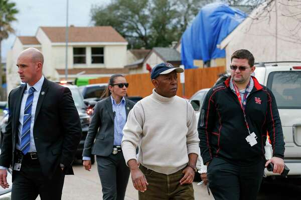 Mayor Sylvester Turner, center, visited Stanford Court, where many homes were heavily damaged during the explosion at Watson Grinding and Manufacturing, on Saturday, Jan. 25, 2020, in Houston.