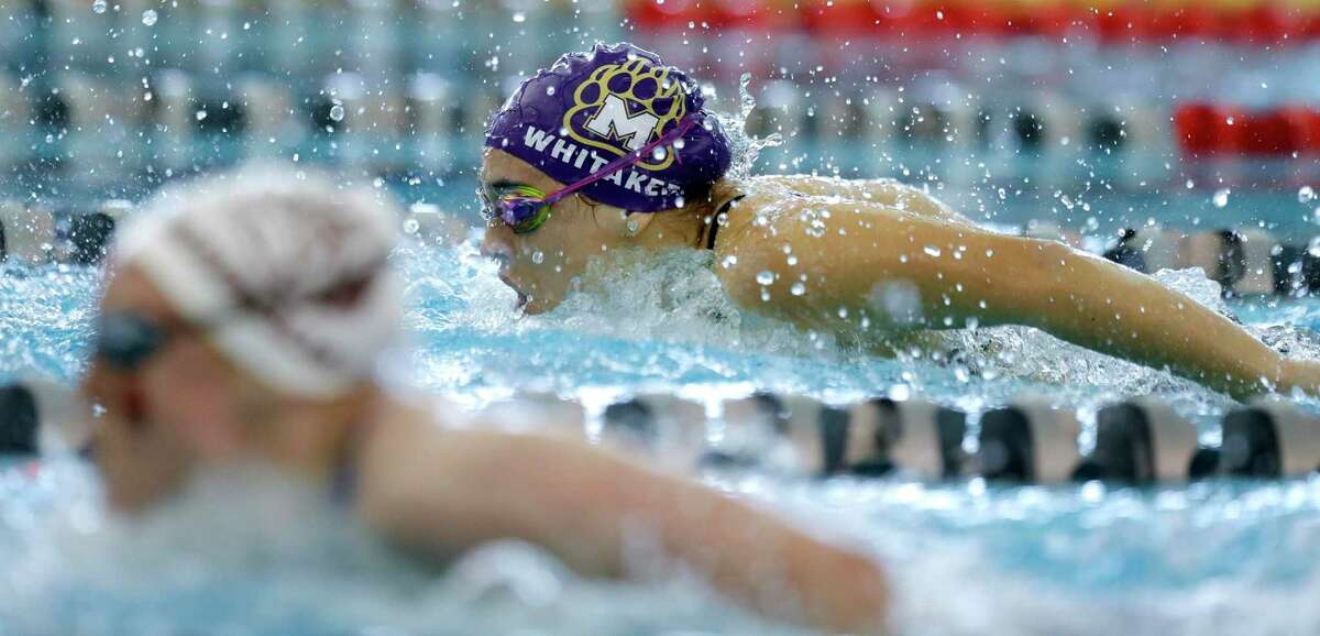 Morgan Whitaker of Montgomery competes in the girls 100-yard butterfly during the District 21-5A swimming championships at the Tomball ISD Aquatic Center, Saturday, Jan. 25, 2020, in Tomball.