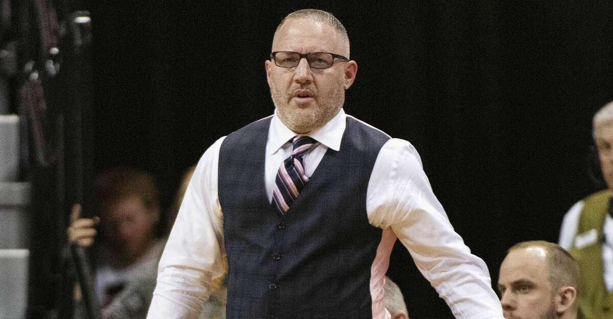 Texas A&M head coach Buzz Williams holds the ball during the first half of an NCAA college basketball game against Missouri Tuesday, Jan. 21, 2020, in Columbia, Mo. (AP Photo/L.G. Patterson)