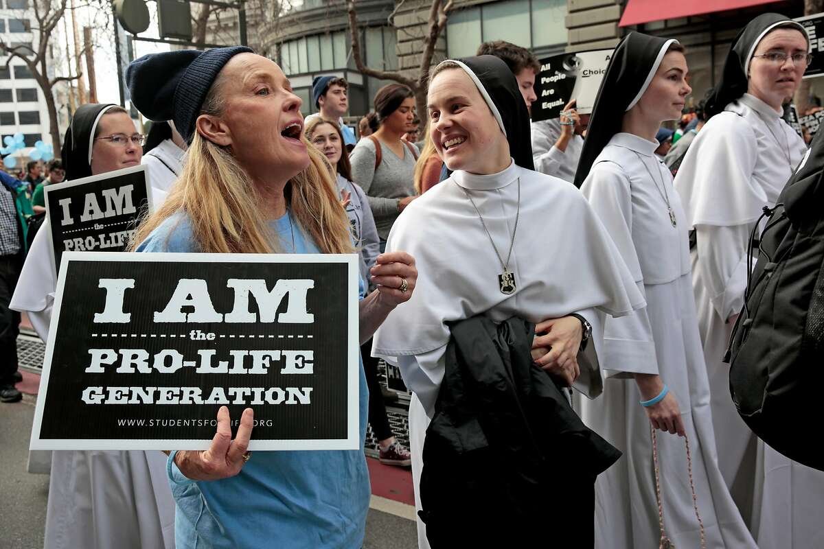 From left: Mary Cresalia and Sister Maria Karol chat during the March for Life demonstration, Saturday, Jan. 25, 2020, in San Francisco, Calif. Demonstrators marched along Market Street from the Civic Center Plaza to protest abortion.