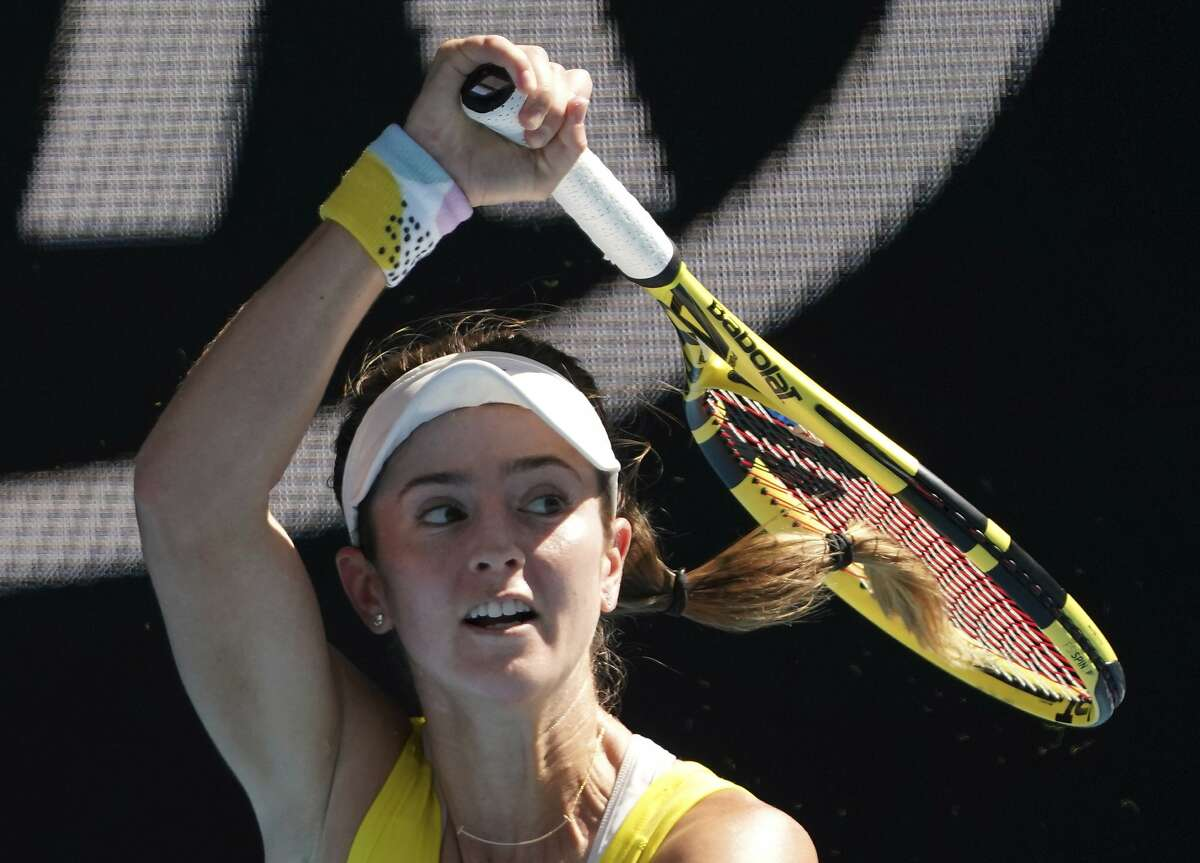 CiCi Bellis of the U.S. makes a forehand return to Belgium's Elise Mertens during their third round singles match at the Australian Open tennis championship in Melbourne, Australia, Saturday, Jan. 25, 2020. (AP Photo/Lee Jin-man)