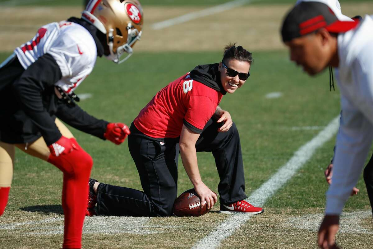 49ers assistant coach Katie Sowers works a drill during practice at 49ers headquarters on Friday, Jan. 24, 2020 in Santa Clara, Calif.