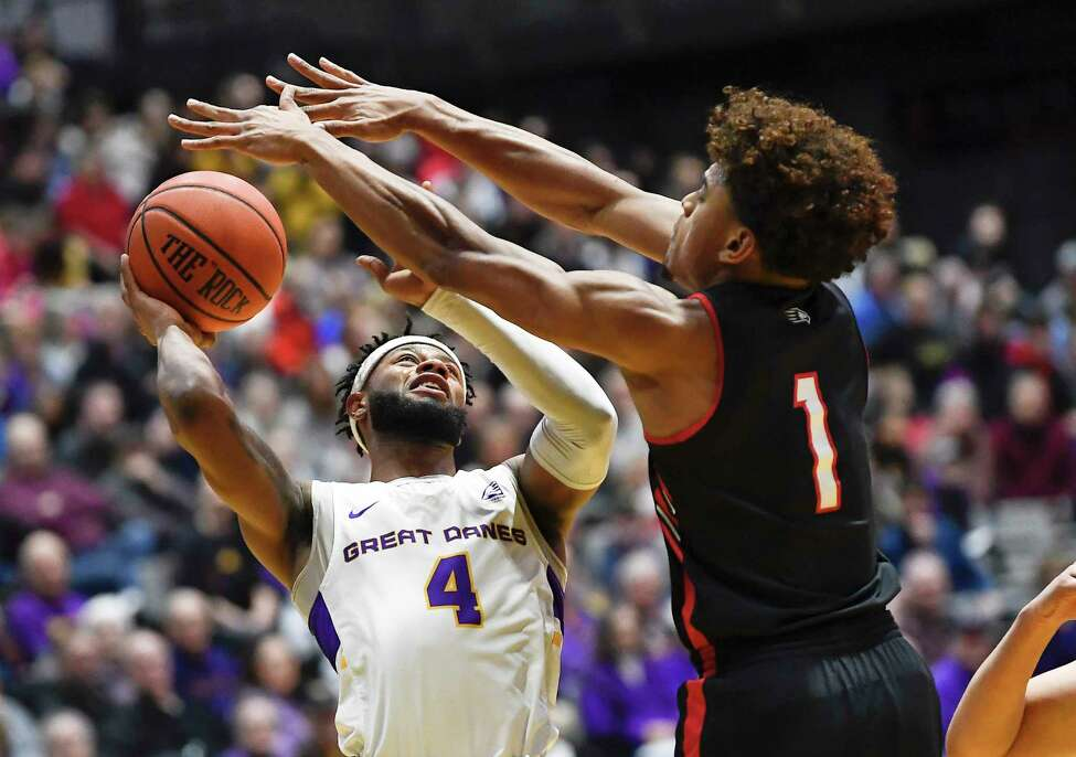 University at Albany guard Ahmad Clark (4) is defended by Hartford guard Malik Ellison (1) during the first half of an NCAA basketball game Saturday, Jan. 25, 2020, in Albany, N.Y. (Hans Pennink / Special to the Times Union) ORG XMIT: 012620_uamen_HP101