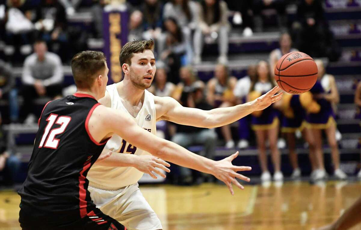 Hartford forward Miroslav Stafl (12) defends against University at Albany forward Adam Lulka (14) during the first half of an NCAA basketball game Saturday, Jan. 25, 2020, in Albany, N.Y. (Hans Pennink / Special to the Times Union) ORG XMIT: 012620_uamen_HP104