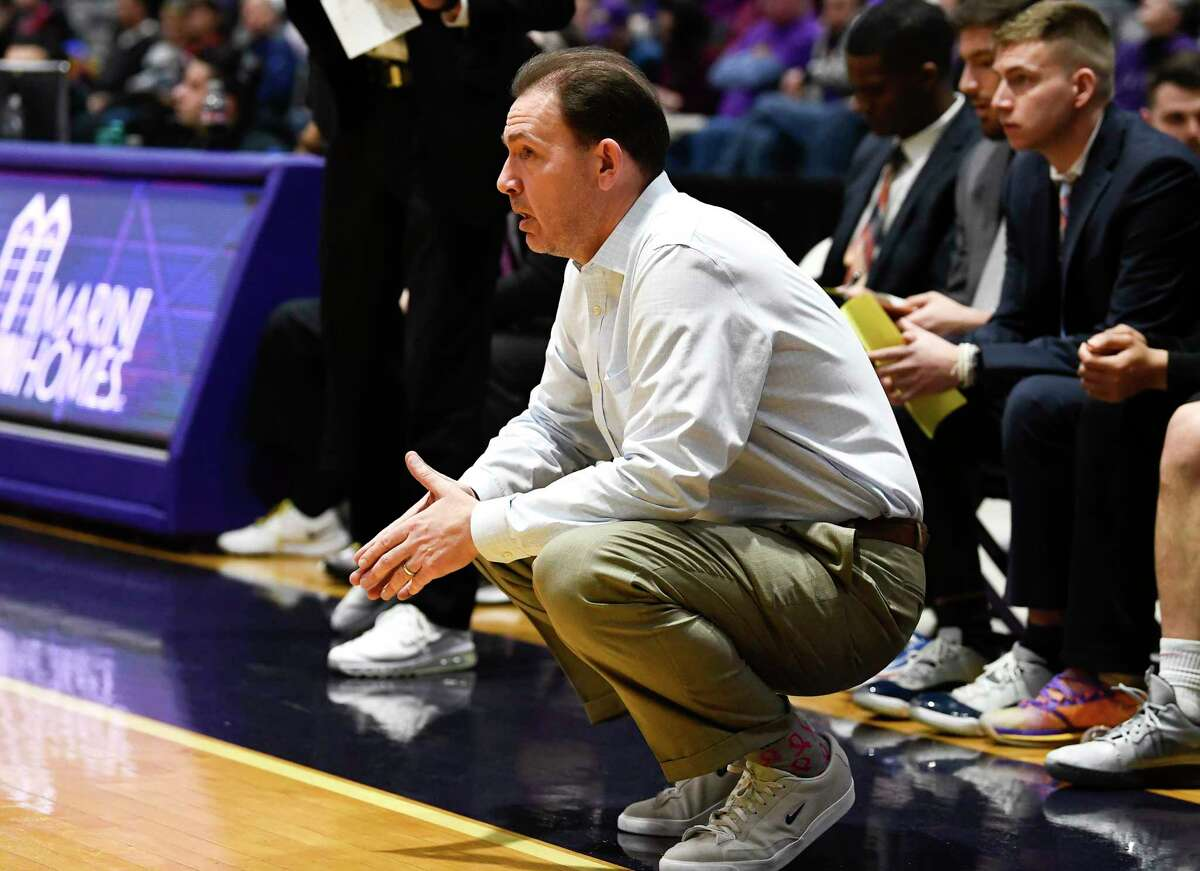 University at Albany head coach Will Brown instructs his players against Hartford during the first half of an NCAA basketball game Saturday, Jan. 25, 2020, in Albany, N.Y. (Hans Pennink / Special to the Times Union) ORG XMIT: 012620_uamen_HP110