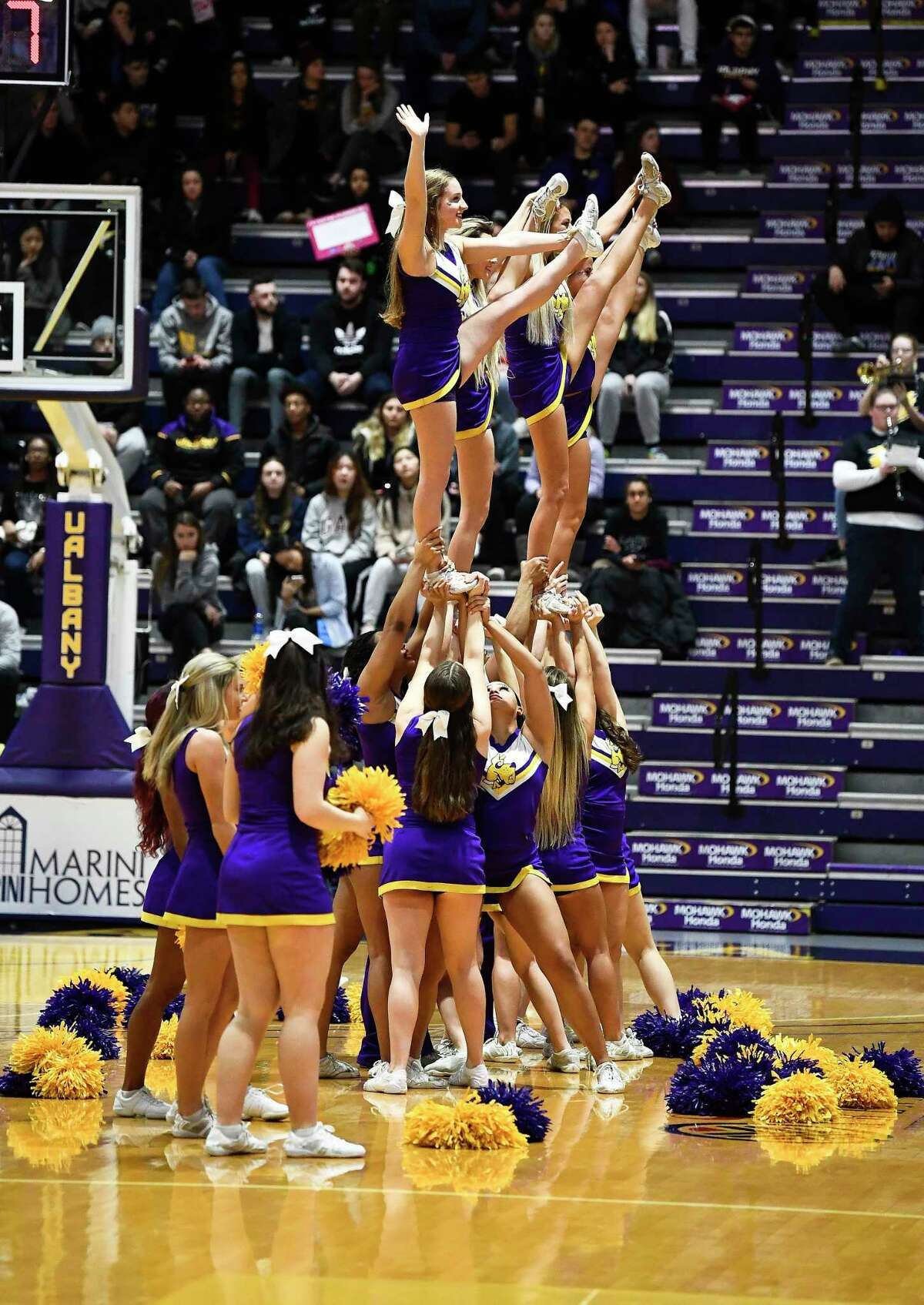 Members of the University at Albany cheer team perform during the first half of an NCAA basketball game against Hartford Saturday, Jan. 25, 2020, in Albany, N.Y. (Hans Pennink / Special to the Times Union) ORG XMIT: 012620_uamen_HP111