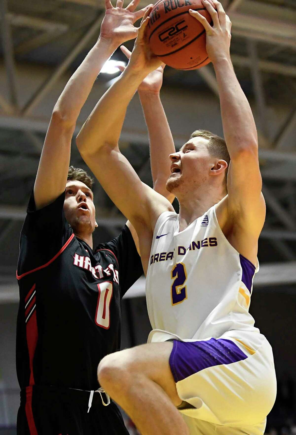 University at Albany guard Trey Hutcheson (2) scores against Hartford forward Hunter Marks (0) during the first half of an NCAA basketball game Saturday, Jan. 25, 2020, in Albany, N.Y. (Hans Pennink / Special to the Times Union) ORG XMIT: 012620_uamen_HP112