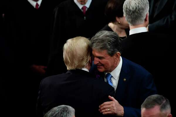 President Donald Trump greets Sen. Joe Manchin, D-W.Va., after the 2018 State of the Union speech.