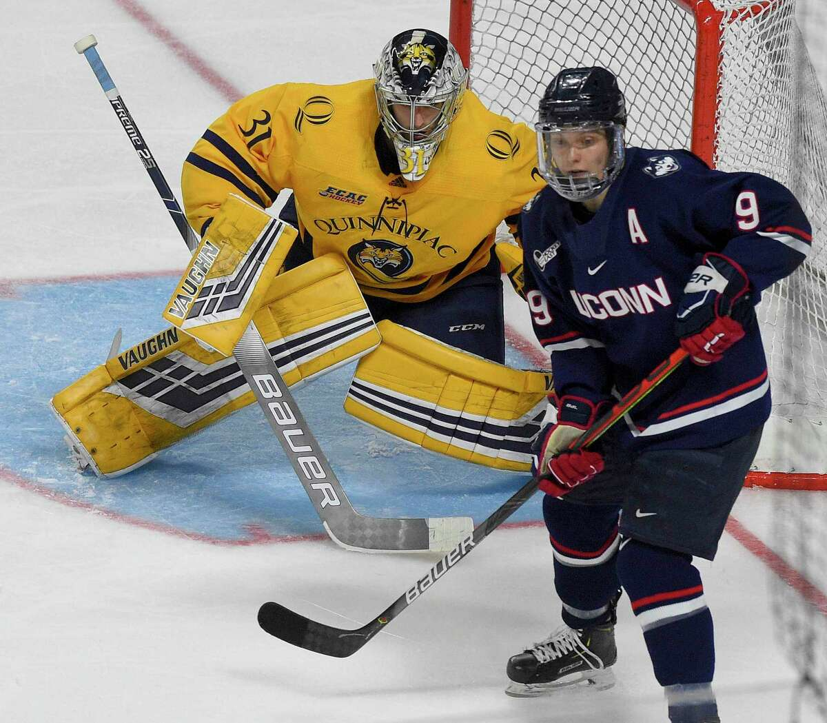 Quinnipiac's goalie Keith Petruzzelli (31) defends the goal against UConn's Alexander Payusov (9) in the second period of the 2020 Connecticut Ice Festival at Webster Arena on Jan. 25, 2020 in Bridgeport, Connecticut.