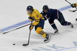 Quinnipiac's Nick Jermain (18) drives up the ice in the second period under pressure from UConn's Adam Karashik (3) in the 2020 Connecticut Ice Festival at Webster Arena on Jan. 25, 2020 in Bridgeport, Connecticut.