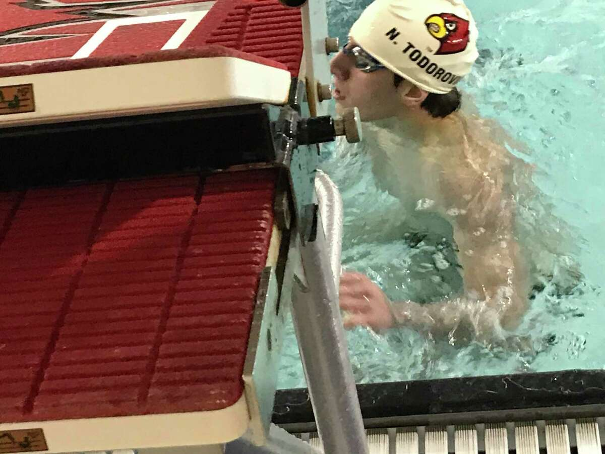 Nick Todorovic looks up at his time after swimming his event during Greenwich's meet against host Fairfield Prep on Saturday.