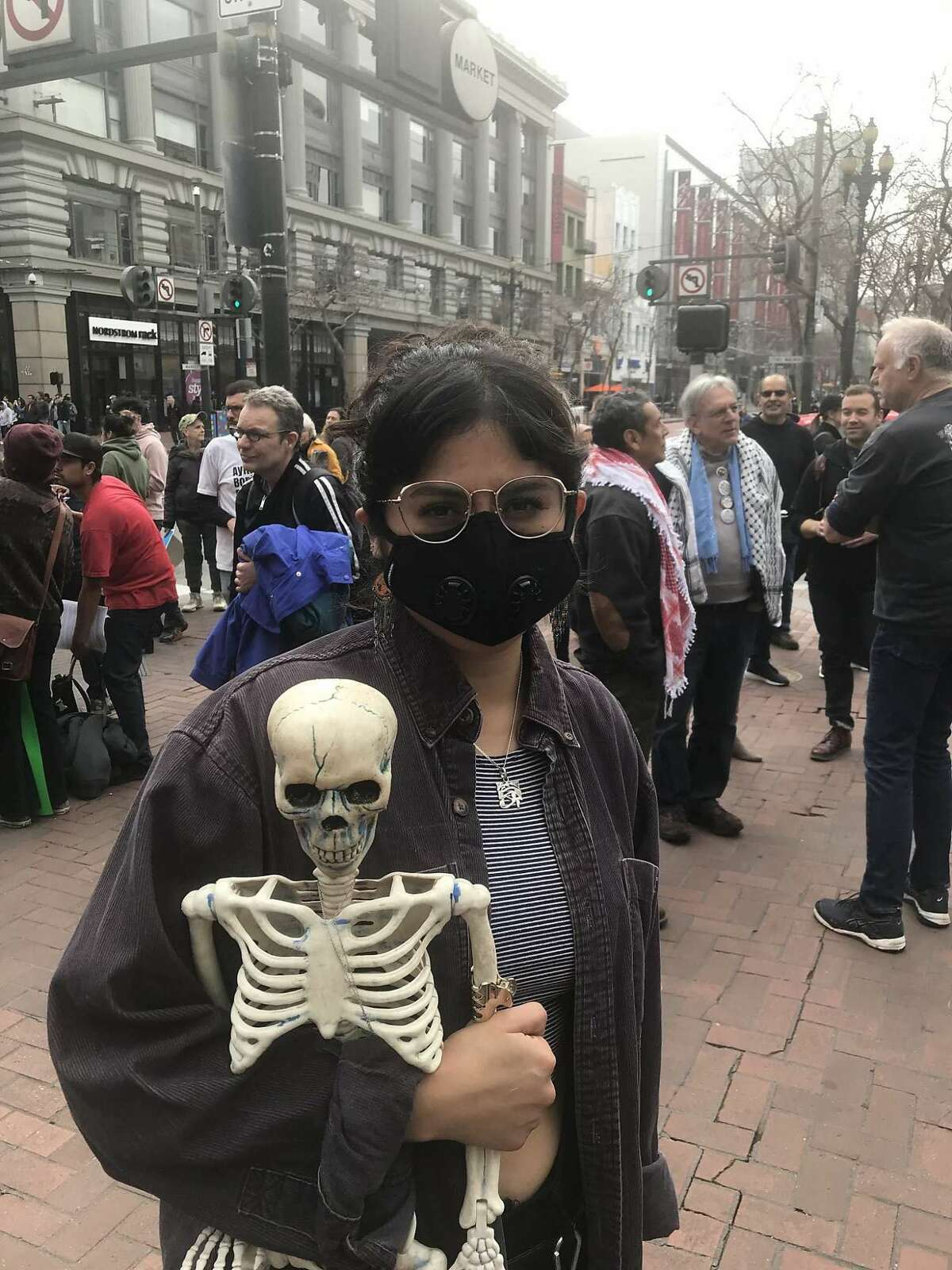 Clara Saenzpardo, 28, of Oakland, joined anti-war protesters during Saturday's march from the cable car turnaround to Union Square