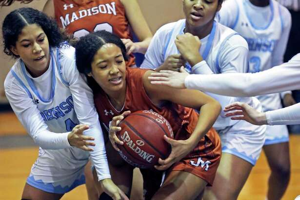 Lady Mav forward Dallasstar Johnson is pressure after a rebound by a crowd of defenders as Johnson hosts Madison in girls basketball at Johnson High School on Jan. 25, 2020.
