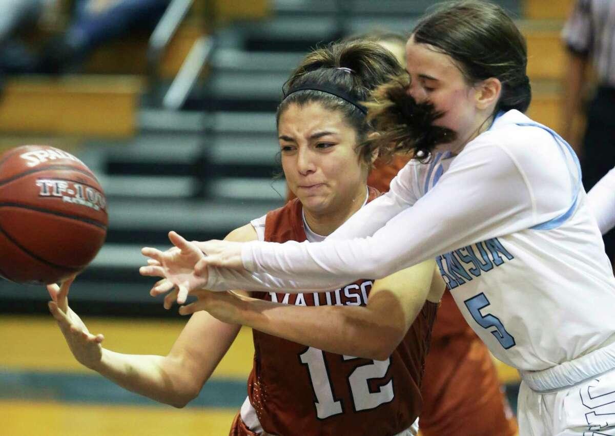 Madison guard Danielle Esquibel (12) battles Kylee Norman for possession as Johnson hosts Madison in girls basketball at Johnson High School on Jan. 25, 2020.