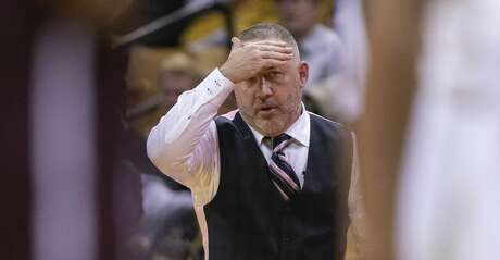 Texas A&M head coach Buzz Williams rubs his head as he watches his players play during the second half of an NCAA college basketball game against Missouri Tuesday, Jan. 21, 2020, in Columbia, Mo. Texas A&M won the game 66-64. (AP Photo/L.G. Patterson)