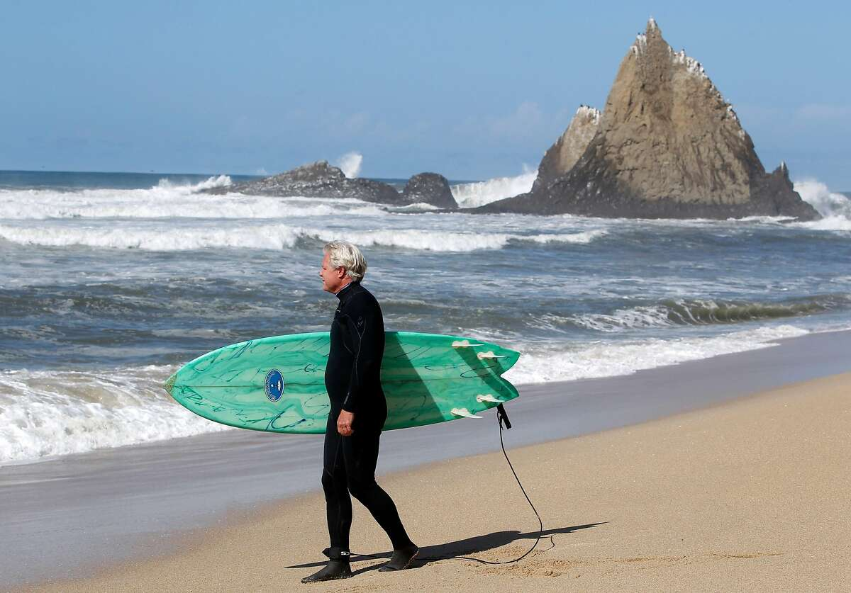 Mark Massara, one of the attorneys representing the Surfrider Foundation, is ready to surf at Martin's Beach in Half Moon Bay, Calif. on Thursday, Sept. 25, 2014, one day after a judge ordered landowner Vinod Khosla to unlock a private gate and allow public access to the beach.