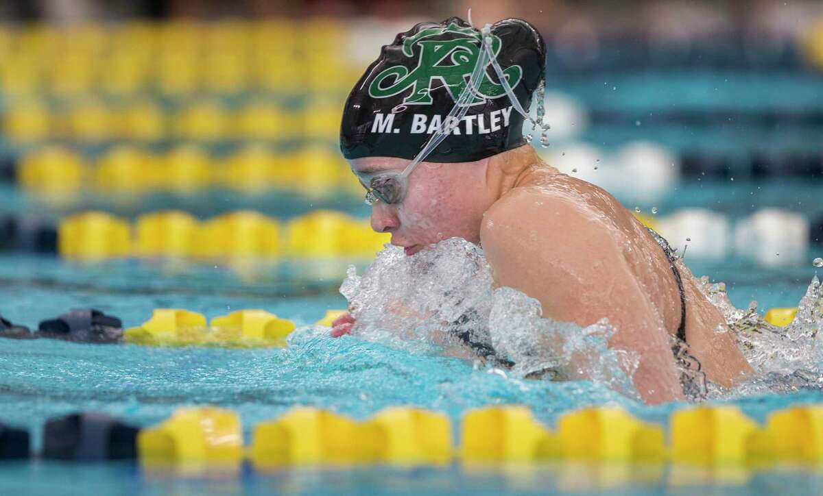 Reagan's Morgan Bartley swims the girls 100-yard breaststroke during the District 26-6A meet at North East ISD's Bill Walker pool in San Antonio on Jan. 25, 2020.