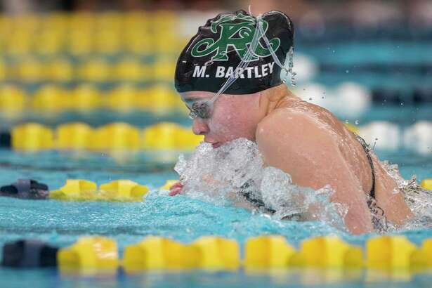 Reagan's Morgan Bartley swims the girls 100 yard breaststroke during the District 26-6A meet at North East ISD's Bill Walker pool in San Antonio on Jan. 25, 2019. The players were competing to qualify for regionals.