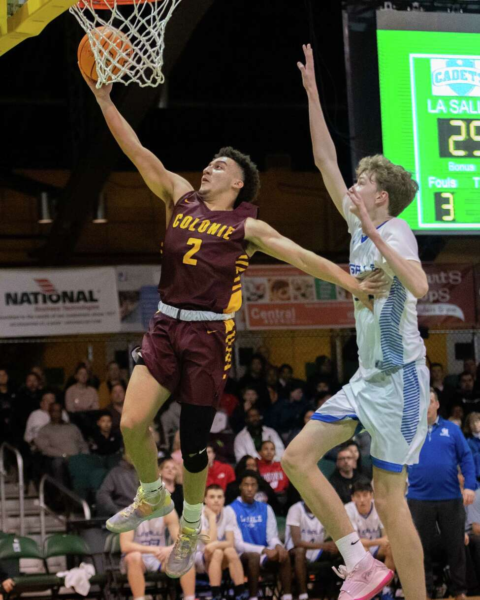 Colonie junior Alfredo Ashon Wright lays one in in front of LaSalle junior Owen Kane during the Slam North South Classic High School Basketball Tournament at the Washington Avenue Armory in Albany NY on Saturday, Jan. 25, 2019 (Jim Franco/Special to the Times Union.)