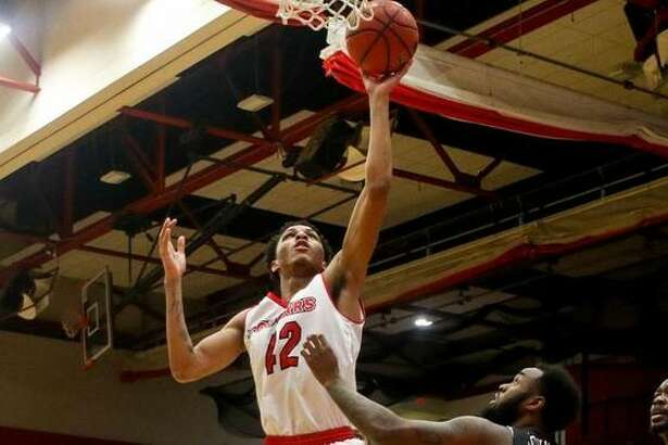 SIUE forward Shamar Wright goes up for a basket during Saturday's game against UT Martin.