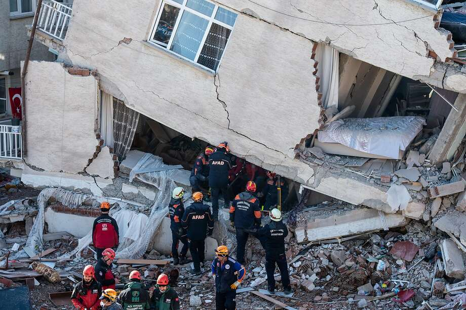 Rescuers search the debris of a collapsed building in Elazig, Turkey, after the quake, which injured more than 1,600 people. Photo: Burak Kara / Getty Images