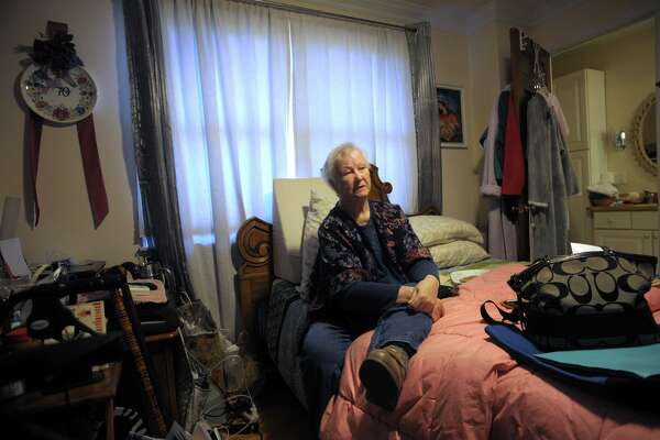 Maria Michaels poses during an interview in the bedroom where she spends most of her time in her home in Stratford, Conn. Jan. 17, 2020. Michaels, 87, is appealing a recent eviction order to vacate the home where she has lived for over 50-years.