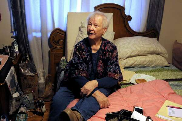 Maria Michaels speaks during an interview in the bedroom where she spends most of her time in her home in Stratford, Conn. Jan. 17, 2020. Michaels, 87, is appealing a recent eviction order to vacate the home where she has lived for over 50-years.