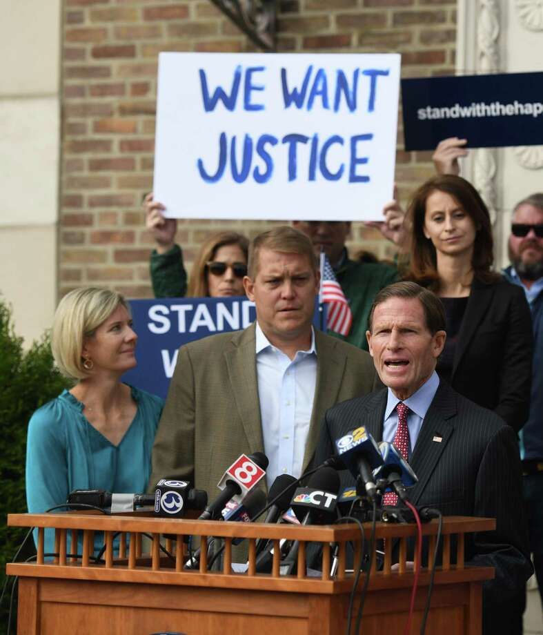 U.S. Sen. Richard Blumenthal, D-Conn., speaks at the podium beside Darien man Scott Hapgood, left, and his wife, Kallie Hapgood, at Town Hall in Darien, Conn. Monday, Oct. 28, 2019 as the town shows support for Scott Hapgood in his manslaughter charge from a family vacation in Anguilla. Hapgood is facing a manslaughter charge regarding the death of a man who the family says attacked Hapgood in his hotel, forcing him to defend himself and his family. A revised autopsy report, based on new toxicology tests, determined the man died from a lethal dose of cocaine and not from injuries he sustained in the fight. U.S. Sen. Blumenthal, Darien First Selectman Jayme Stevenson, and friends and family are asking for a fair and transparent trial, as well as guaranteed safe passage, as Hapgood returns to Anguilla to face charges. Photo: Tyler Sizemore / Hearst Connecticut Media / Greenwich Time