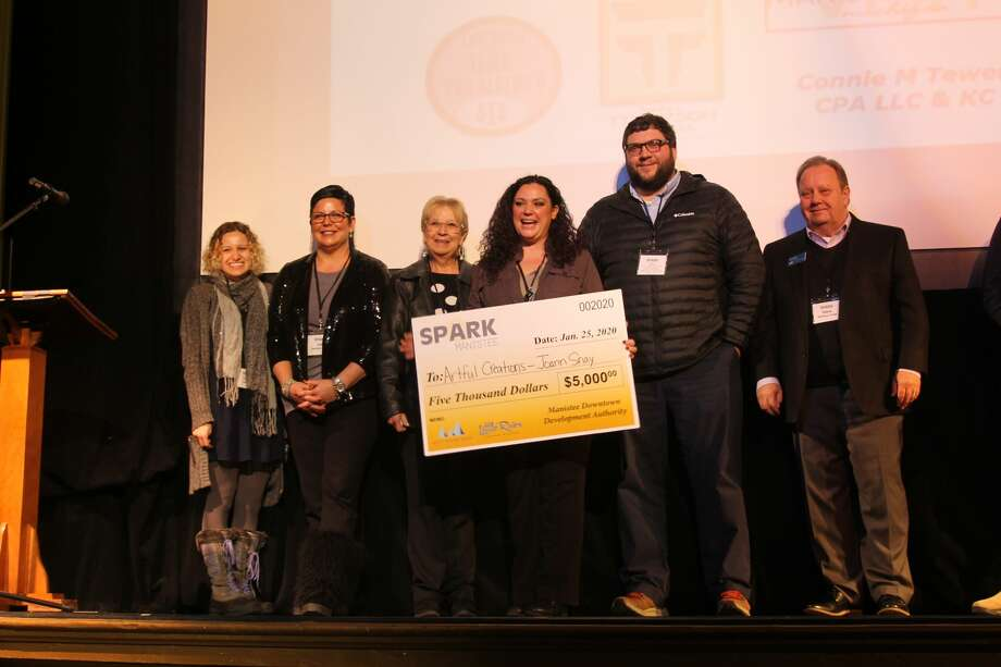 Joann Snay, owner of Artful Creations was named the winner of Manistee's second Spark Manistee competition. Five local entrepreneurs went head-to-head in the competition on Saturday at the Ramsdell Theatre, and one winner took home the $5,000 prize along with other exclusive perks. Photo: Michelle Graves/News Advocate