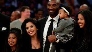 LOS ANGELES, CA - DECEMBER 18: Kobe Bryant poses with his family at halftime after both his #8 and #24 Los Angeles Lakers jerseys are retired at Staples Center on December 18, 2017 in Los Angeles, California. NOTE TO USER: User expressly acknowledges and agrees that, by downloading and or using this photograph, User is consenting to the terms and conditions of the Getty Images License Agreement. (Photo by Harry How/Getty Images)