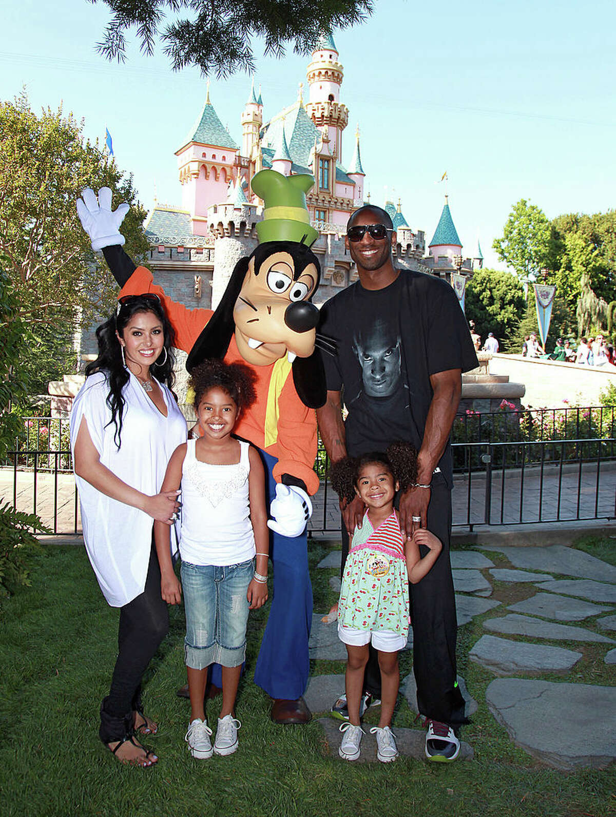 In this handout image provided by Disney, Los Angeles Lakers star Kobe Bryant (R), wife Vanessa Bryant (L) and daughters Natalia (2nd from R) and Gianna (3rd from R) celebrate the Lakers' NBA championship with Goofy at Disneyland on June 22, 2010 in Anaheim, California. (Photo by Paul Hiffmeyer/Disney via Getty Images)