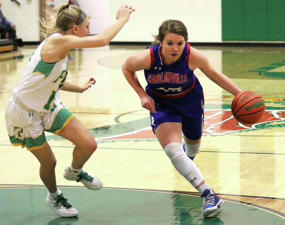 Carlinville's Gracie Reels (right) drives past Southwestern's Morgan Durham during a Jan. 9 Piasa Birds victory in Piasa. On Saturday night in Staunton, all-tourney selection Reels and the Cavaliers avenged that loss to the Birds with an overtime victory in the title game of the Macoupin County Tournament. Photo: Greg Shashack / The Telegraph