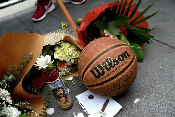 A makeshift memorial honoring former NBA basketball player Kobe Bryant appears outside of Staples center prior to the start of the 62nd annual Grammy Awards on Sunday, Jan. 26, 2020, in Los Angeles. Bryant died Sunday in a helicopter crash near Calabasas, Calif. He was 41.