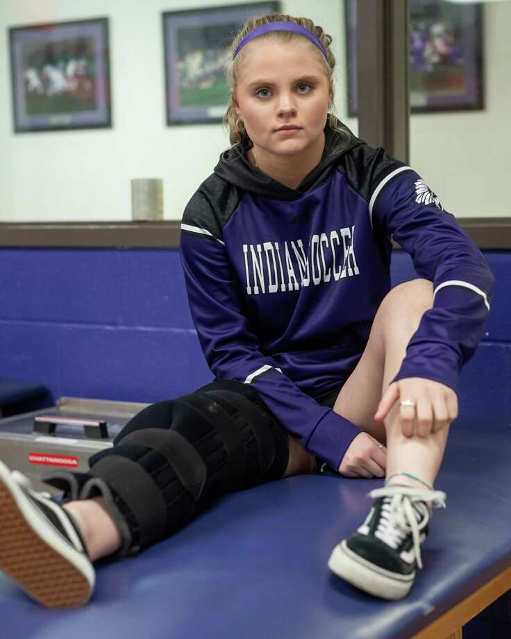 Indians goalkeeper Kaylee Hooper sits with a brace on her leg in the trainers room in the Port Neches-Groves High School Fieldhouse on January 23, 2020. Fran Ruchalski/The Enterprise Photo: Fran Ruchalski/The Enterprise / 2019 The Beaumont Enterprise