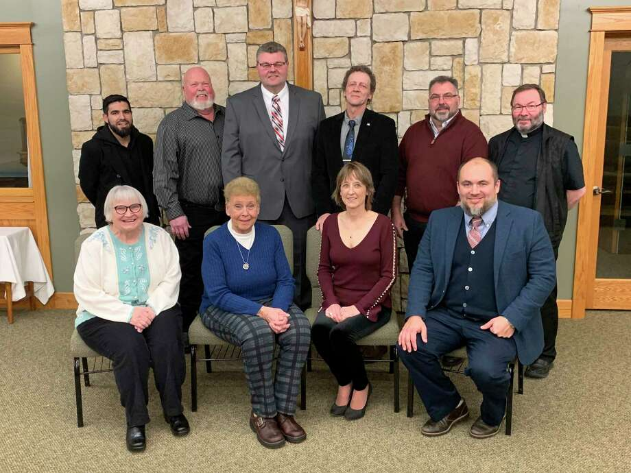 The 2020 Hall of Fame inductees at Manistee Catholic Central were honored on Saturday during a special dinner. Pictured (front row, left to right) are Christy Wissner, Mary Beth Bowerman, Cyndi Luomala, principal Jeremie Solak, (back row) Father Pablo Martinez, Jeff Seng, Scott Schmeling, KerryLuomala, Jim Kaminski, Father Zeljko Guberovic. (Courtesy photo)