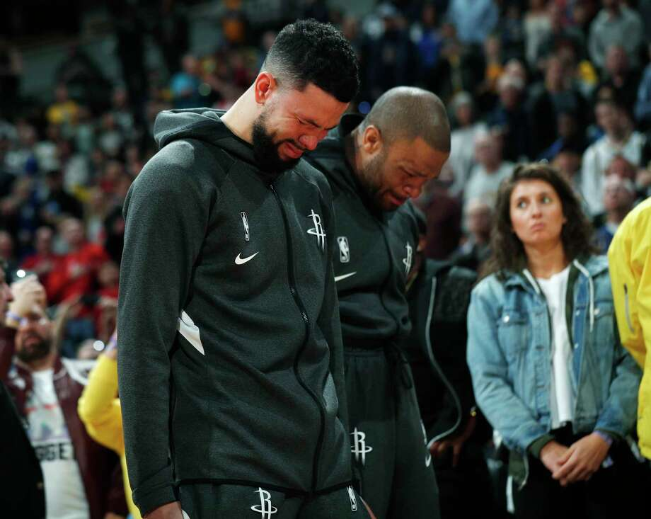 PHOTOS: A look at the moment of silence before Sunday's Rockets-Nuggets game in Denver Houston Rockets guard Austin Rivers and forward P.J. Tucker react during a tribute to NBA star Kobe Bryant before an NBA basketball game against the Denver Nuggets, Sunday, Jan. 26, 2020, in Denver. Bryant died in a California helicopter crash Sunday. (AP Photo/David Zalubowski) Photo: David Zalubowski, Associated Press / Copyright 2020 The Associated Press. All rights reserved.