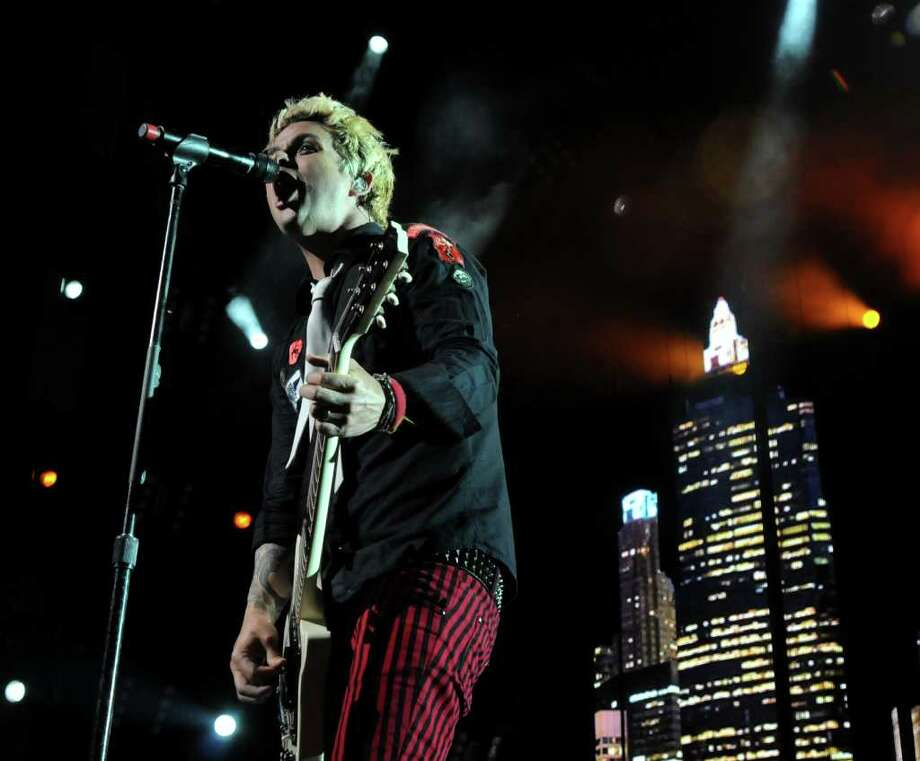 Green Day's lead singer and guitarist, Billie Joe Armstrong, performs live with the band at The Comcast Theatre in Hartford on Thursday evening Aug. 12, 2010. Photo: Lisa Weir / The News-Times Freelance