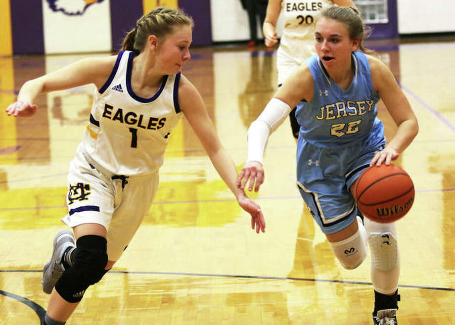 Jersey's Clare Breden (right), shown on the break against defensive pressure from CM's Tori Standefer in a Jan. 7 MVC game in Bethalto, scored 18 points Saturday in a Carrollton Tourney victory over Gateway Legacy. Photo: Greg Shashack / The Telegraph