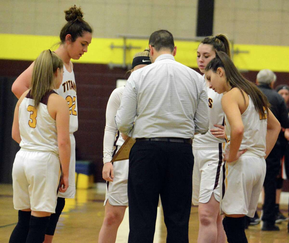 Sheehan coach Mike Busillo talks to his team during a timeout on Thursday.