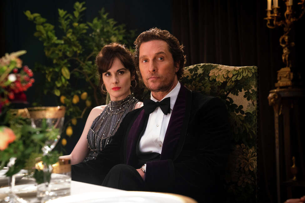This image released by STXfilms shows Michelle Dockery, left, and Matthew McConaughey in a scene from