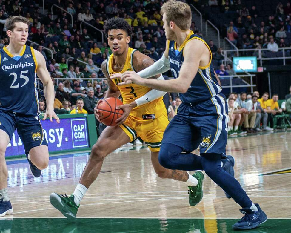 Siena junior Manny Camper drives to the basket in front of Quinnipiac junior Rich Kelly at the Times Union Center in Albany NY on Sunday, Jan. 26, 2019 (Jim Franco/Special to the Times Union.)