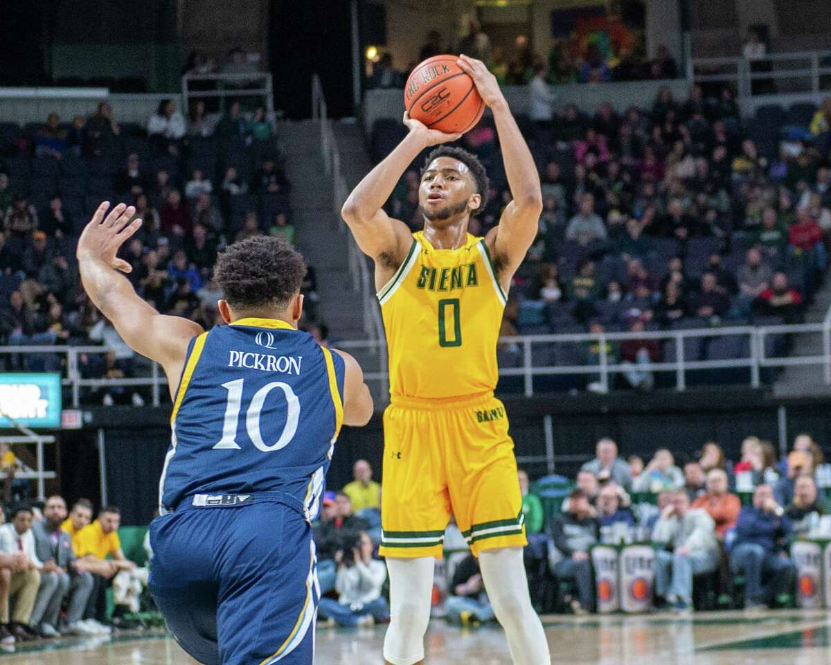 Siena sophomore Donald Carey takes a jumper in front of Quinnipiac sophomore Tyree Pinkney at the Times Union Center in Albany NY on Sunday, Jan. 26, 2019 (Jim Franco/Special to the Times Union.)